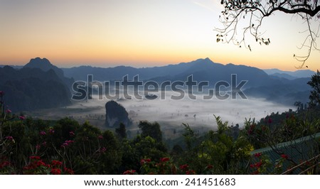 Misty morning light on the top of the mountain hills. Phu Langka  panorama view. - stock photo