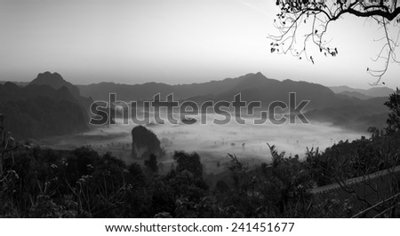 Misty morning light on the top of the mountain hills. Phu Lanka black and white tones. - stock photo