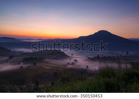 Misty morning sunrise in Khao Takhian Ngo View Point at Khao-kho Phetchabun,Thailand - stock photo