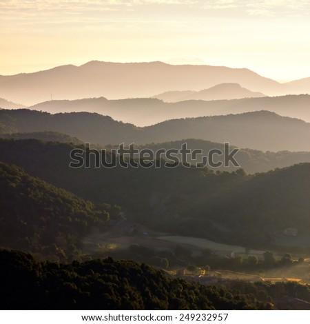 Misty mountains landscape in La Garrotxa, Catalonia - stock photo