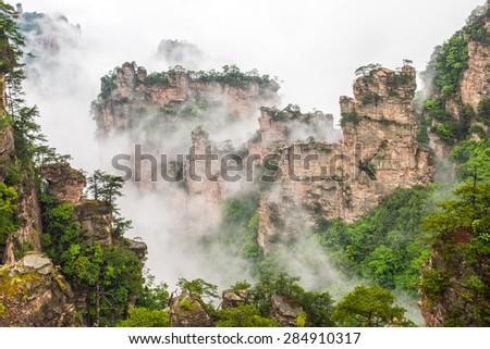 Misty steep mountain peaks - Zhangjiajie national park,China - stock photo