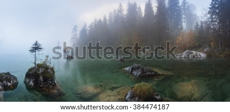 Misty summer morning on the Hintersee lake in Austrian Alps. - stock photo