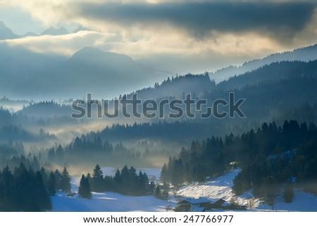 misty sunset in Alps, Bavaria, Germany - stock photo