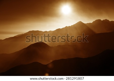misty view of hills and valleys in the atlas mountains, morocco - stock photo