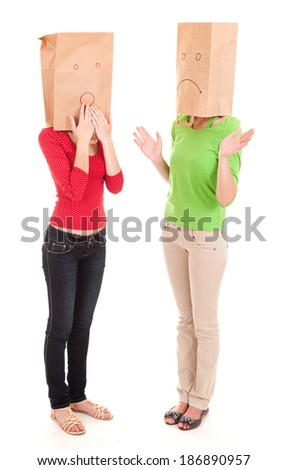 misunderstanding, two girls with paper heads, white background - stock photo