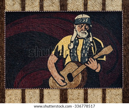 MITCHELL, SOUTH DAKOTA - OCTOBER 27: Mural of corn husks on the walls of the Corn Palace on October 27, 2015 in Mitchell, South Dakota - stock photo