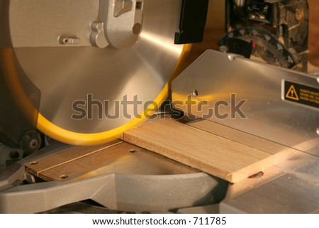 miter saw cutting wood - stock photo