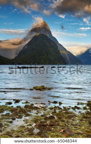 Mitre Peak at sunrise, Fiord Milford Sound, New Zealand - stock photo