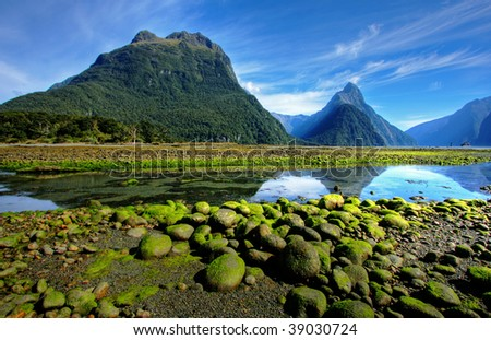 Mitre Peak in New Zealand at low tide - stock photo