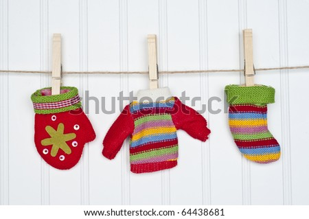 Mitten, Sweater and Warm Sock on a Clothesline.  Holiday Concept. - stock photo