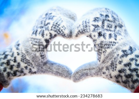 mittens heart on winter background - stock photo
