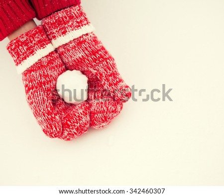 Mittens in snow. Red knitted gloves in winter - stock photo