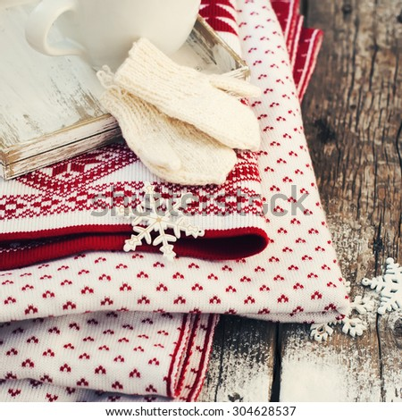 Mittens, Snowflakes and Plaid on Wooden Background. Christmas Things - stock photo