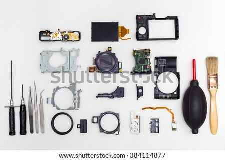 Mix all camera part on white background,Top view,Repair camera concept,Camera broken,Camera damage - stock photo