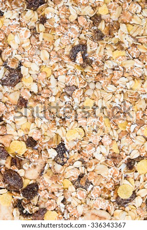 Mix cereal with raisins, oat, conflake and nuts background texture. - stock photo