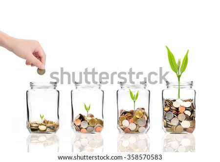 Mix coins in clear bottle on white background,Business investment growth concept,saving concept,Hand putting coins and seed in clear jar over white background - stock photo