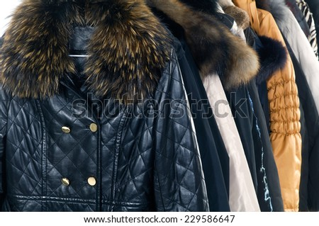 Mix color f casual autumn/winter coat fashion clothing on hanging - stock photo