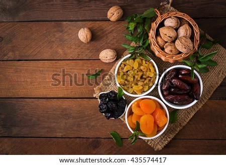Mix dried fruits (date palm fruits, prunes, dried apricots, raisins) and nuts, and traditional Arabic tea. Ramadan (Ramazan) food. Top view - stock photo
