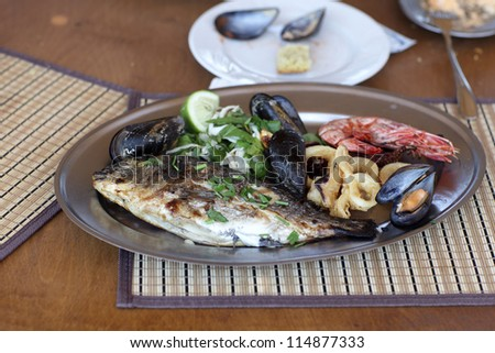 Mix fish plate in a seafood restaurant - stock photo