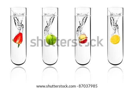 Mix fruit dropped in chemical test tube, Biotechnology, Genetically Modified Organisms - stock photo