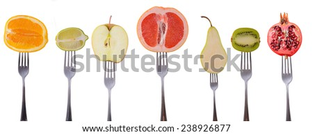 Mix fruit on a fork on a white background - stock photo