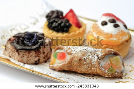 Mix italian  pastries with cannolo - stock photo