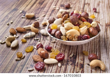 Mix nuts and dry fruits on wooden background - stock photo