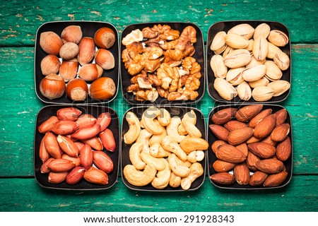 Mix nuts on wooden table,healthy  vegan food. - stock photo