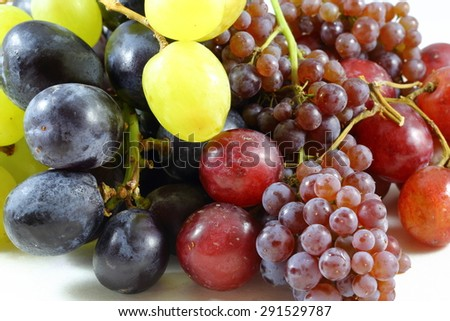 Mix of black green red and champagne grapes  - stock photo