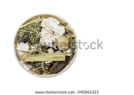 Mix of chinese herbal medicine in wooden dish isolated on white background - stock photo