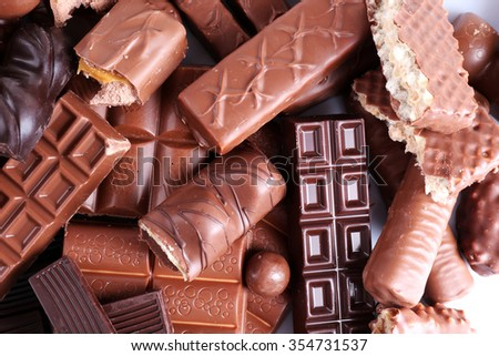 Mix of chocolate on table, close-up - stock photo