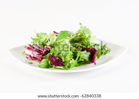 Mix of crisp and sweet lettuce leaves on white background - stock photo