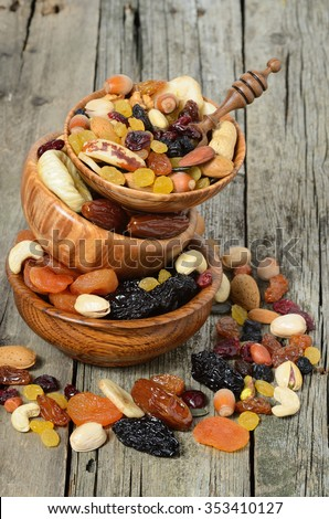 Mix of dried fruits and nuts in a wooden bowl - symbols of judaic holiday Tu Bishvat.  - stock photo