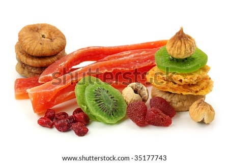 Mix of dried fruits isolated on white background - stock photo