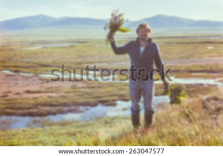 Mix of flowering tundra, beautiful summer and positive people emotion through soft blurring effect - vintage photo taken in July 1979, Chukchi Peninsula, USSR   - stock photo