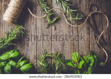 Mix of fresh herbs from garden on an old table - stock photo