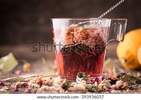 Mix of healthy herbal tea on vintage wooden background - stock photo