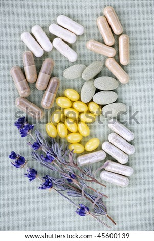 Mix of herbal supplements and vitamin pills - stock photo