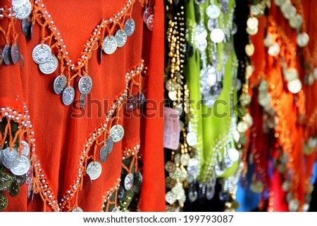 Mix of Indian multicoloured fabrics and shawls  - stock photo