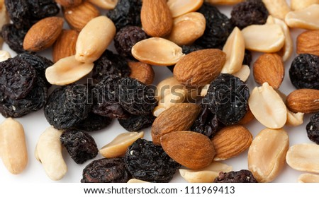 Mix of nuts and raisins on white - stock photo