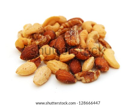 Mix of nuts close up on white - stock photo