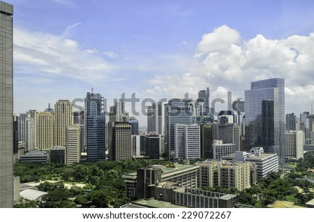 Mix of old and modern urban buildings in Makati City, Manila, Philippines - stock photo