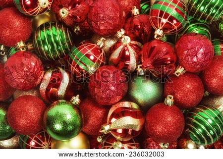 Mix of red, green, and golden Christmas ball ornaments - stock photo