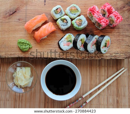 Mix of sushi with soy sauce and wooden chopsticks - stock photo
