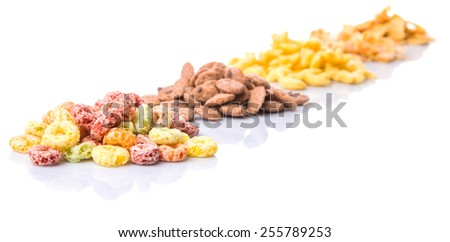 Mix variety of breakfast cereals over white background - stock photo