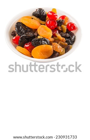 Mix variety of dried fruit in white bowl over white background - stock photo