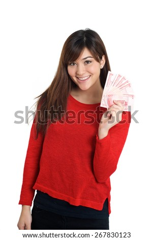 Mixed Asian girl holding a few bills of Chinese money - stock photo