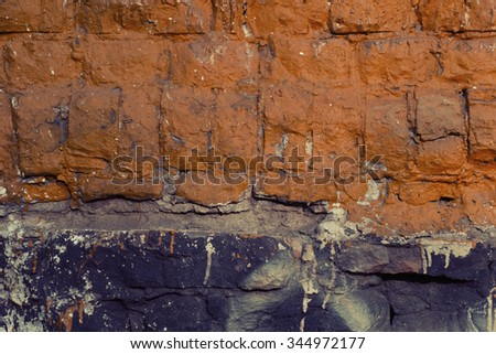 Mixed black and yellow brick wall texture background. Vintage effect. - stock photo