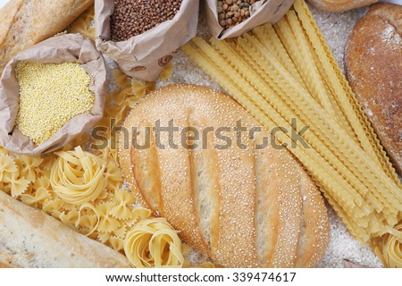 Mixed breads, macaroni and grains background, close up - stock photo