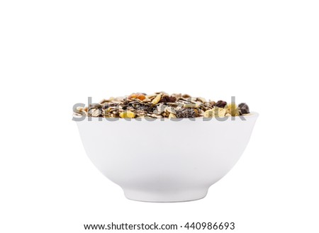 mixed cereal flakes with dried fruit chips in a white chinaware bowl - stock photo